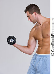 Muscular man workout biceps with dumbbell