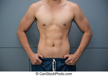 Muscular men who have good health and nice body, Gym