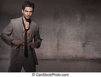 Muscular young model wearing trendy suit