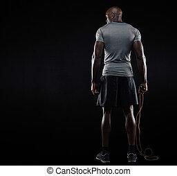 muscular, posição homem, com, corda saltando