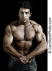 Muscular powerful man showing his muscles