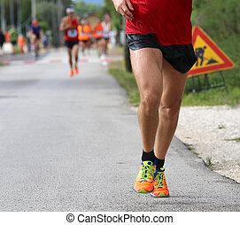 muscular runner during a marathon race