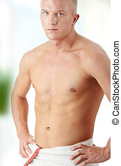 Muscular sexy man wrapped in the towel