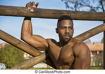 Muscular Shirtless Black Man in Park