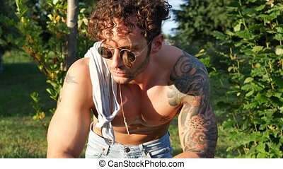 Muscular Shirtless Hunk Man Outdoor in Countryside