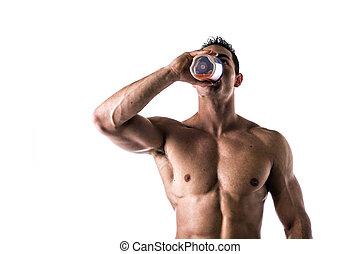 Muscular shirtless male bodybuilder drinking protein shake...
