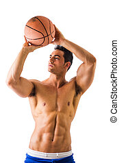 Muscular shirtless male model throwing basketball ball