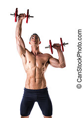 Muscular shirtless young man exercising shoulders with dumbbells
