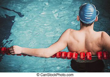 Muscular swimmer in a swimming pool
