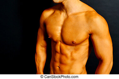 Athletic shirtless male with tanned skin and rippled muscles