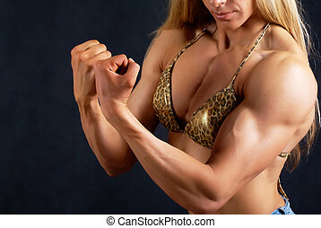 Muscular woman - Close-up of female muscular trunk in bikini...