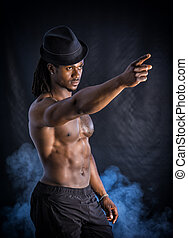 Muscular young black man with grey fedora hat
