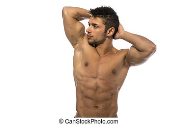 Muscular young bodybuilder showing biceps and ripped abs -...