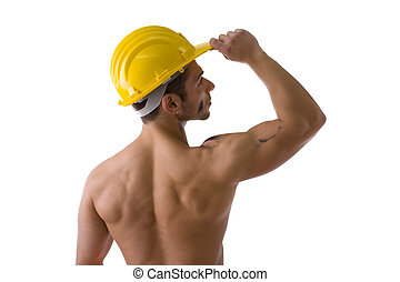 Muscular young construction worker shirtless with hardhat