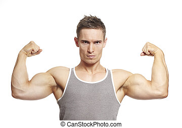 Muscular young man flexing arm muscles in sports outfit smiling on white background