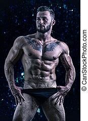 Muscular young man standing shirtless