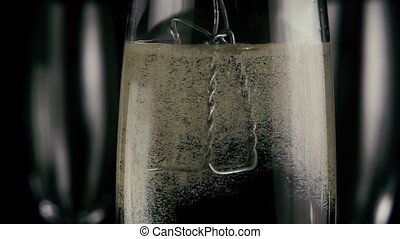 Muselet in a glass with champagne. Slow motion
