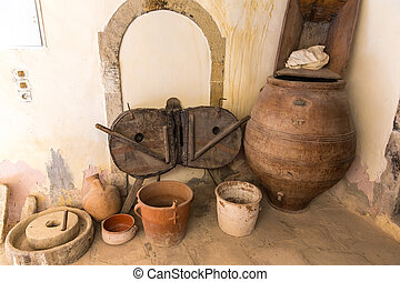 Museum with artifacts of ancient Greek pottery and clay (jug, pot, vase) in monastery in Messara Valley Crete, Greece
