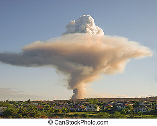 Mushroom cloud - smoke plume high in the sky over Maui