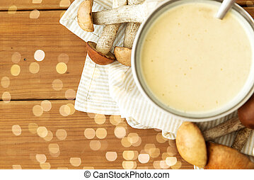 mushroom cream soup in bowl on cutting board