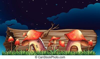 Mushroom houses in garden at night