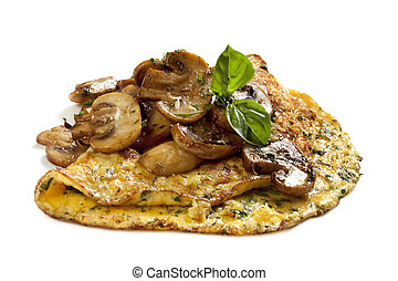 Herb and mushroom omelette, garnished with basi, isolated on whitel. Delicious!