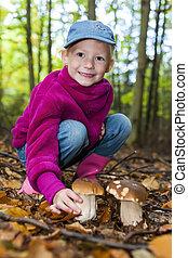 mushroom picking little girl in forest