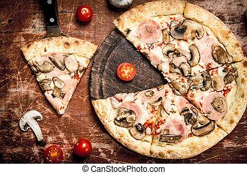 Mushroom pizza with ham.