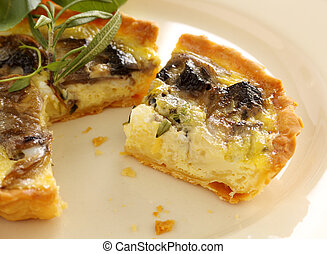 Fresh baked mushroom quiche sliced and ready to serve.