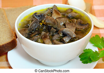 Mushroom soup in a white bowl