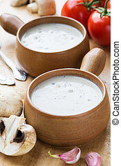 Mushroom soup in clay pots