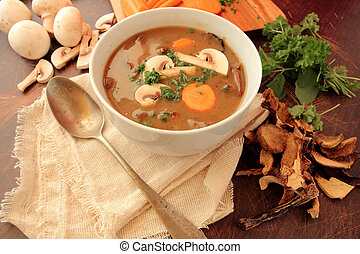 Mushroom soup with fresh parsley, carrot and champignons