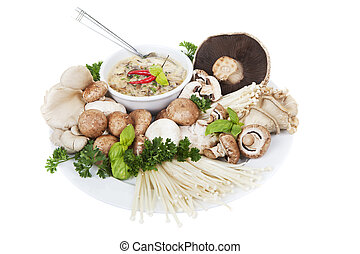 Mushrooms and soup - A plate of mixed mushrooms with a bowl...