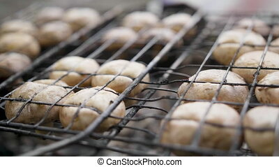 Mushrooms brown champignon cooked on grill or barbecue...