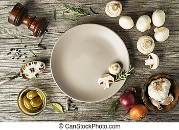 Mushrooms champignons with fresh ingredients on wooden...