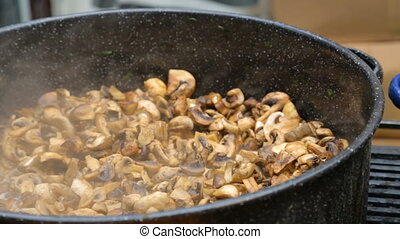 Mushrooms cooked in a large pot