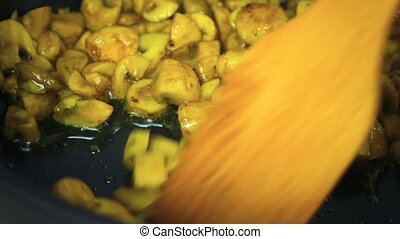 Mushrooms fried with oil in a frying pan
