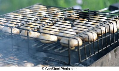 Mushrooms on barbecue grill - Chef cooks mushrooms on...