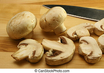 Mushrooms on Cutting Board With Knife