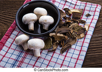 Mushrooms on wooden background