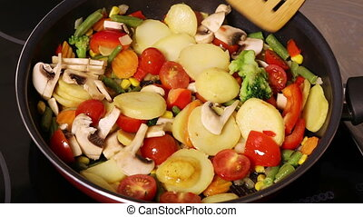 Mushrooms with vegetables fried in a pan - Mushrooms with...