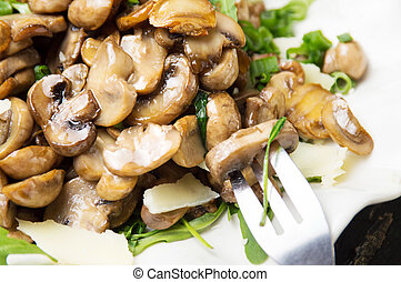 Mushrooms with vegetables on a white plate