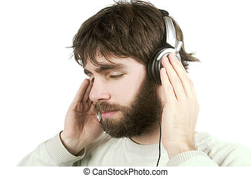 A young male with a beard listening to music on headphones. Isolated on white with clipping path.