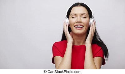 happy singing girl with headphones