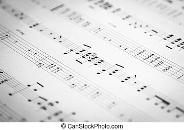 Close-up shot of sheet music, selective focus, shallow depth of field.