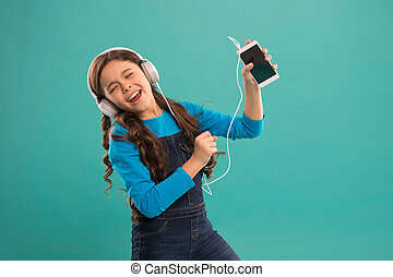 Music application. Best music apps for free. Enjoy perfect sound. Girl child listen music modern headphones and smartphone. Listen for free. Subscription channel. Enjoy music concept.