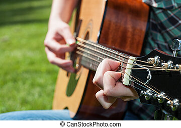 Music artist - A young music artist playing the classic...