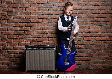 music at school - Modern little girl in school uniform...