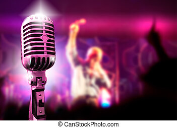 Music background with vintage microphone and concert