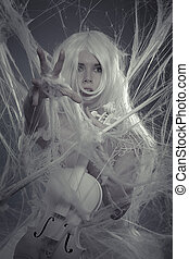 Music, beautiful woman trapped in a spider web with a white violin, lace dress